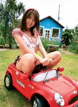 Busty asian schoolgirl in red swimsuit..